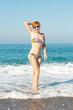 woman in swimwear on the beach .