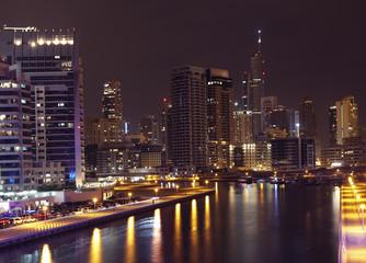 Fototapeta na wymiar Town scape at night time. Panoramic scene, Dubai.