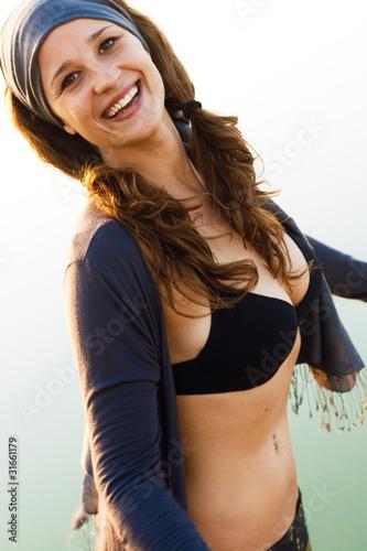 Fototapeta portrait of young woman enjoying a summer day obraz na płótnie