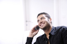 Young Man Using Telephone