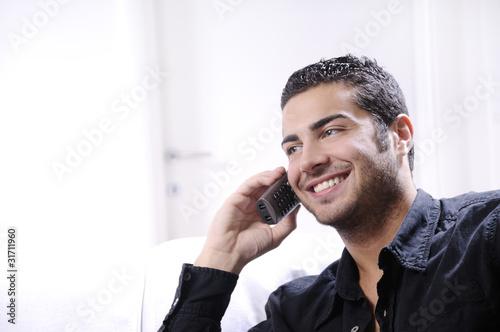 Obraz young man using telephone - fototapety do salonu