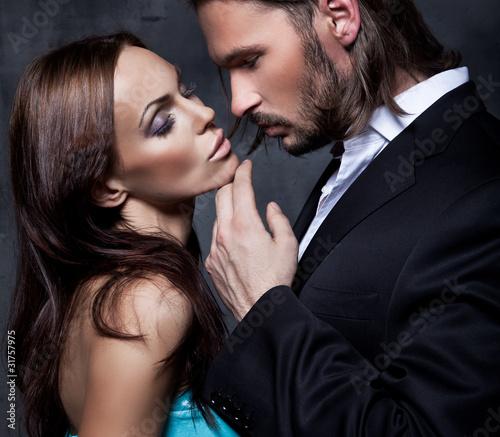 Fototapeta romantic portrait of the kissing couple obraz
