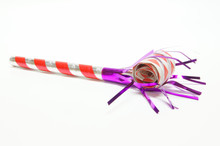 A Single Party Blower On A White Background