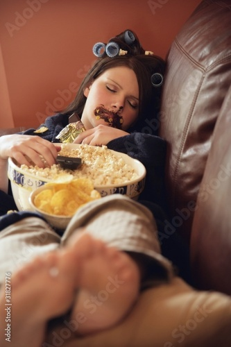 Fotografie, Obraz  Young Woman Binging On Junk Food