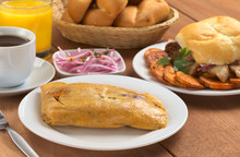 Peruvian Breakfast With Tamal (cooked Corn With Meat)