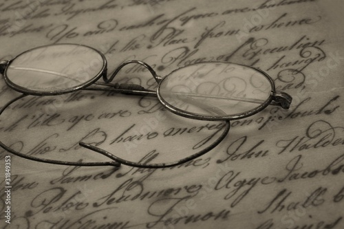 Old glasses on the vintage document Canvas Print