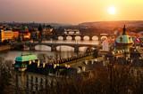 Panoramic view on Charles bridge and sunset Prague lights