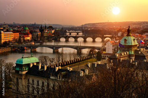 Panoramic view on Charles bridge and sunset Prague lights. Poster