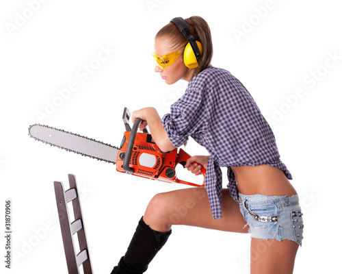 Valokuva  Young woman with a chainsaw
