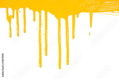 Orange paint dripping / isolated on white / real photo