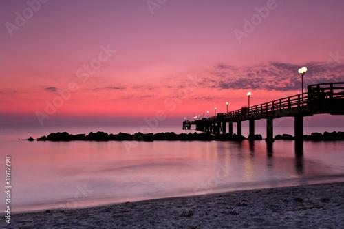 Foto op Canvas Candy roze Wustrow Seebrücke am Abend