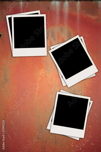 Three Blank Photos on Metal Background