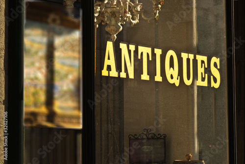 Fotografie, Obraz  Antique store window sign wilth gold letters