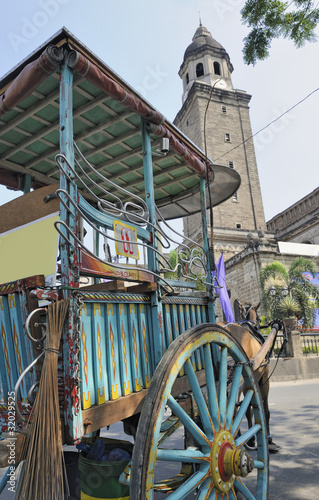 Horse and cart in front of church of San Augustin, Manila