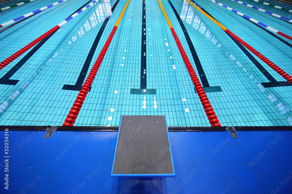 Fototapeta In center one platform for  start and lane of swimming pool