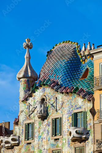 Photo  Antoni Gaudi.Facade is decorated with mosaic tiles
