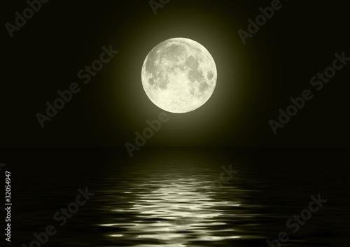 Fototapeta The full moon in the night sky reflected in water obraz na płótnie