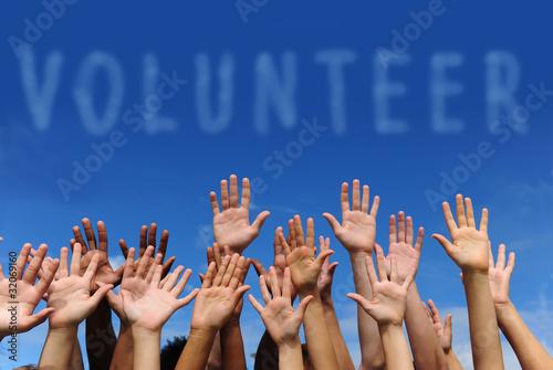 Fotografía  volunteer group raising hands