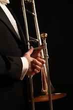 A Concert Musician Holds A Trombone