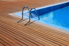 Blue Swimming Pool With Teak W...