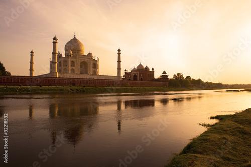 Sunset at the Taj Mahal reflected in the Yamuna River. Wallpaper Mural