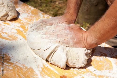 Deurstickers Bakkerij Man hands kneading dough