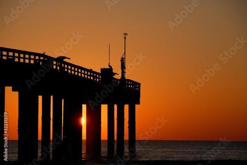 fishing pier at sunrise st augustine beach florida usa Canvas Print