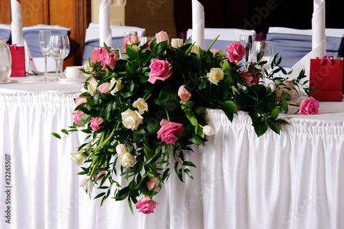 Head table at wedding reception decorated