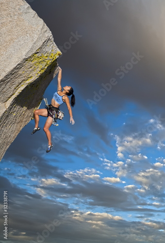 Rock climber clinging to a cliff. Poster