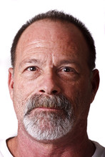 Old Guy With Gray Beard And Mustache Looking Straight On Serious