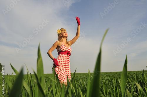 Fotografie, Obraz  woman standing in a field