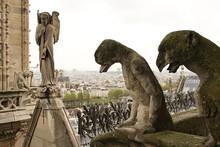 Notre Dame De Paris: Chimeras And An Angel Sculpture