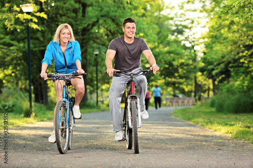 Photo Stands Cycling Happy couple biking in the park