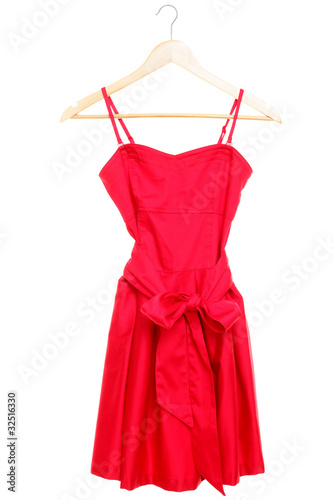 Plakát Red dress on hanger isolated