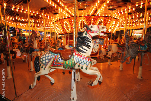 Beautifully decorated carousal horses on a merry-go-round Fototapet