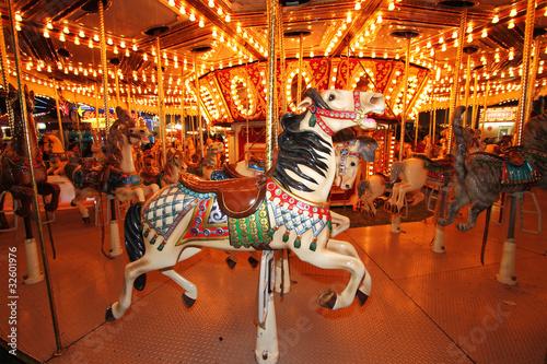Vászonkép Beautifully decorated carousal horses on a merry-go-round