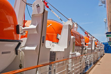 Row Of Orange Lifeboats By Dec...