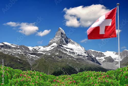 Fotografie, Obraz  Beautiful mountain Matterhorn with Swiss flag - Swiss Alps