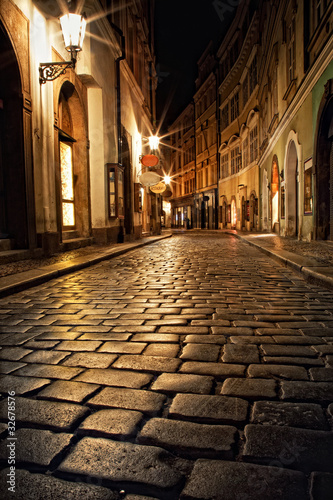 narrow alley with lanterns in Prague at night Poster