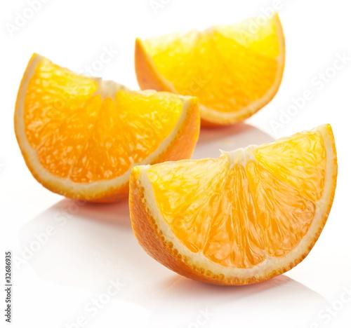 Orange slice on a white background. Fototapete