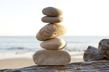 Rock Stack On Driftwood With C...