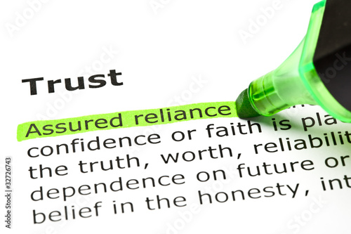 Fotografía  Dictionary definition of the word Trust Assured reliance highlighted under the t
