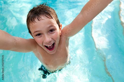 Fotografie, Obraz  Joyful kid in a swimming pool.