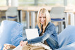 Young happy high-school student relax with laptop