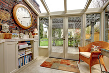 Garden Room Wall With Clock And Book Shelves