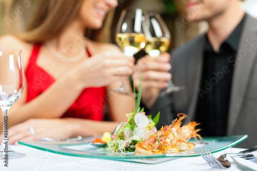 Fotografie, Obraz  Abendessen oder Mittagessen in Restaurant