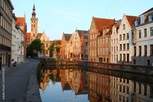 Poster Brugge Jan van Eyckplein: old town of Bruges in Belgium at sunset time