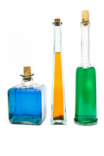 Three Antique Bottles With Colorful Liquids
