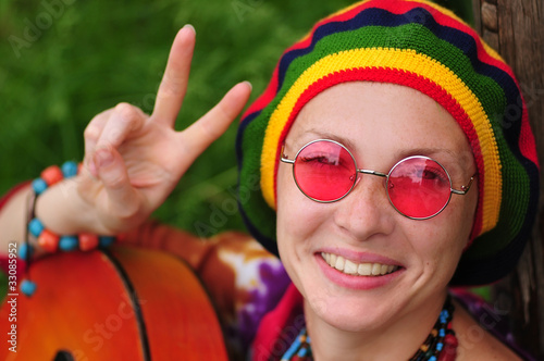Valokuvatapetti Young hippy woman making peace sign