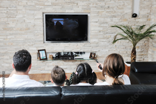 Cuadros en Lienzo family wathching flat tv at modern home indoor